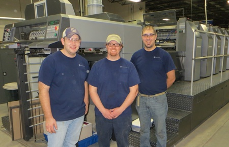 From left to right are Wausau press operators Dallas Ingersoll, Chris Habeck, and Mike Plisch.
